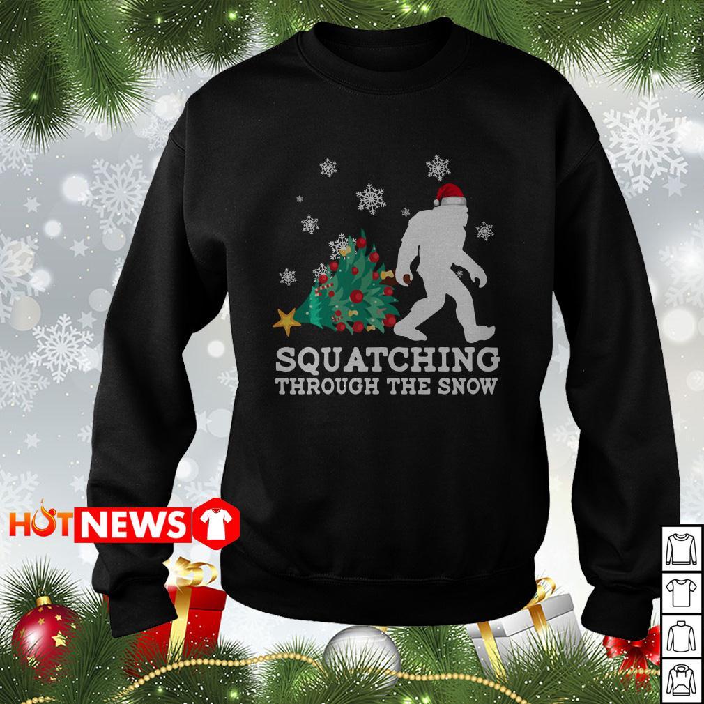 Merry Christmas Bigfoot Santa squatching through the snow sweater